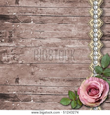 Old Wooden Background With A Rose, Paper Flowers, Pearls
