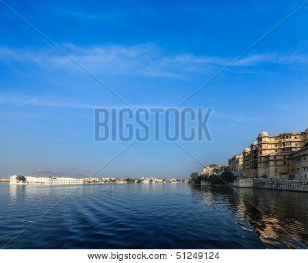 Romantic India luxury tourism concept background - Udaipur City Palace, Lake Palace and Lake Pichola. Udaipur, Rajasthan, India