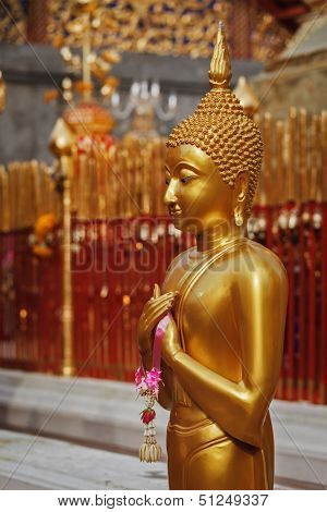 Standing Buddha statue in Wat Phra That Doi Suthep, Chiang Mai, Thailand