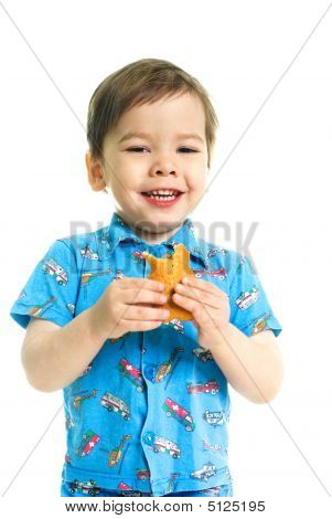 Happy Boy Eating A Cookie