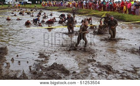 Runners in the Mud Pit