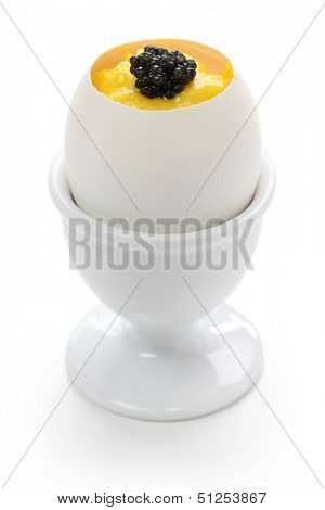 caviar and scrambled egg in egg shell cup