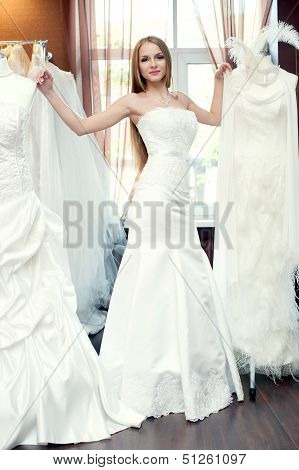 The Bride Trying On Dresses In The Bridal Salon
