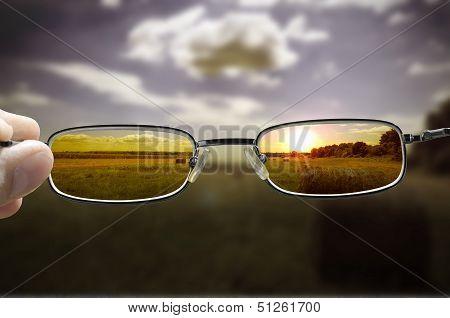 seeing sunset through glasses