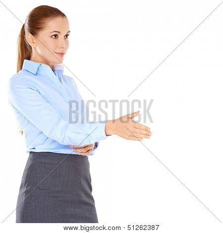 Businesswoman offering to shake hands holding out her hand with a look of anticipation as she closes a deal  congratulates a colleague or greets a client