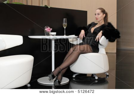 Woman Sitting In Luxury Interior