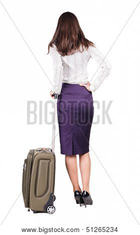 Back view brunette business woman with suitcase looking up. Standing young girl. Rear view people collection. backside view of person. Isolated over white background. languid girl in heels looks