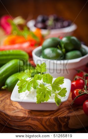 Antipasto and catering platter with raw vegetables and yogurt dip