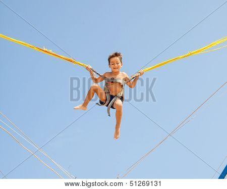 Boy Jumping On Trampoline