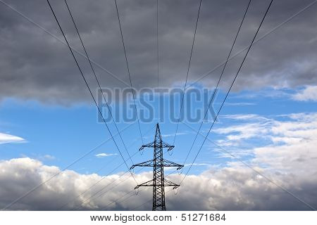 Power Supply Tower In Front Of Some Impressive Cloudy Sky