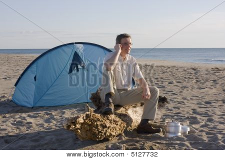 Man With Tent On Beach