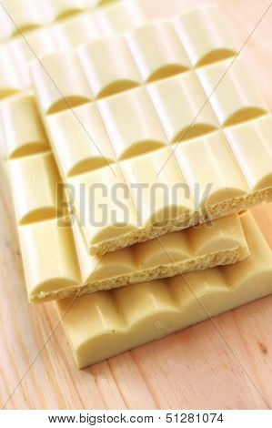 White Chocolate On Wooden Background
