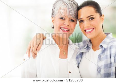portrait of beautiful mature mother and young daughter