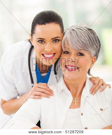 portrait of friendly medical nurse and senior patient