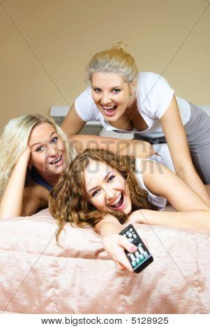Three Freinds Watching Tv