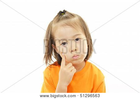 Little Asian girl uneasy look