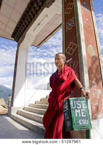 Thimpu, Bhutan - October 20, 2010: Monk Leaning On A Trash Bin On Oct. 20, 2010 Near Thimpu