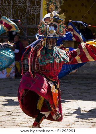Jakar, Bhutan - October 24, 2010: Masked Man Are Dancing At The Jakar Tsechu On Oct. 24, 2010 In Jak