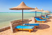 stock photo of under sea  - Relax under parasol on the beach of Red Sea - JPG
