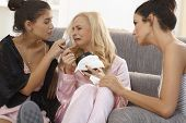 stock photo of nighties  - Female friends comforting crying girl at home - JPG
