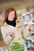 Shopping Series - Red Hair Woman Buying Shampoo poster
