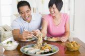 stock photo of sm  - Couple Eating Food Healthy Eating Home Cooking mealmealtime 30s Asian Casual Clothing Chinese Chopsticks Color Colour Dining Room Domestic Life Enjoying Happy Holding Home Horizontal Image Indoors Inside Laughing Man mealmealtimetimes Mid Adult Sitting Sm - JPG