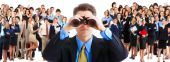 stock photo of human resource management  - businessman with binoculars looking at the business people - JPG