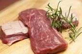 pic of duck breast  - raw duck breast on cutting board - JPG