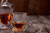 stock photo of whiskey  - Glass of scotch whiskey on a wooden table - JPG