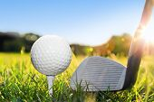pic of striking  - Golf ball on white tee and golf club preparing to shot - JPG