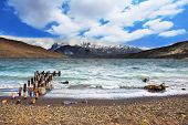 Crazy wind Patagonia. The scenic Lake Laguna Azul and a boat dock in national park Torres del Paine,