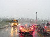 stock photo of flood-lights  - Heavy rush hour traffic in the rain - JPG