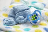 stock photo of pacifier  - Layette for newborn baby boy - JPG