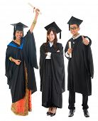 picture of malay  - Full body group of multi races university student in graduation gown standing isolated on white background - JPG