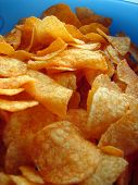 stock photo of potato chips  - potato chips in blue bowl - JPG