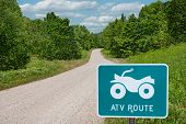 stock photo of four-wheelers  - A road sign identifies a route for all - JPG