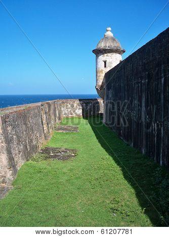 Between the outer walls of Castillo de San Cristobal