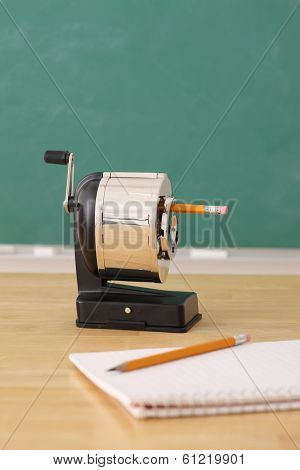 School education still life of a pencil sharpener and notepad