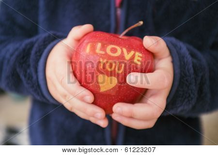 Child Holding Apple