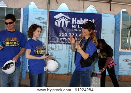 LOS ANGELES - MAR 8:  Rick Hearst, Rebecca Herbst, Lisa LoCicero at the 5th Annual General Hospital Habitat for Humanity Fan Build Day at Private Location on March 8, 2014 in Lynwood, CA