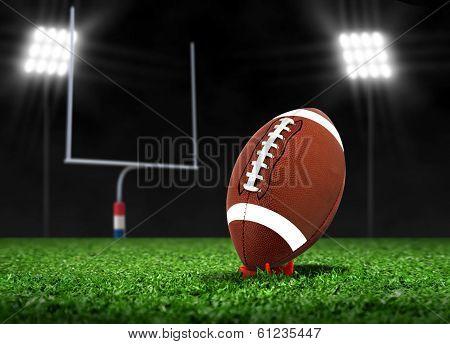 Football Ball On Grass Under Spotlights