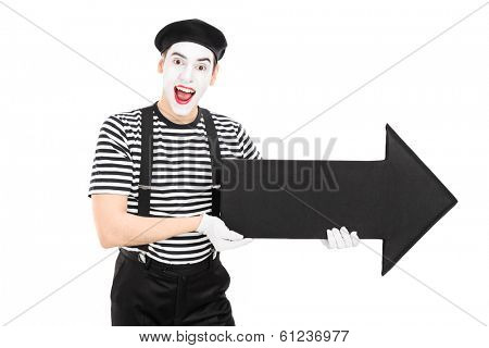 Male comedian holding a big black arrow pointing right isolated on white background