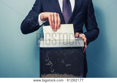 Businessman Shredding Documents