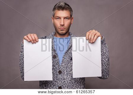 man serious holding papers isolated