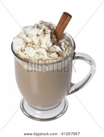 Coffee beverage in glass mug with whipped cream and cinnamon topping on white