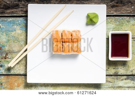 Seafood Sushi Rolls In White Plate With Chopsticks And Japanese Spices