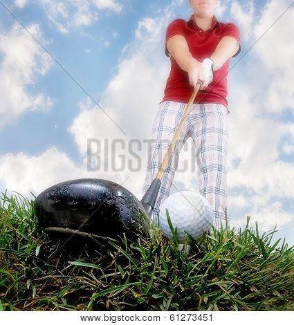 a person playing golf as seen through a wide angle lens