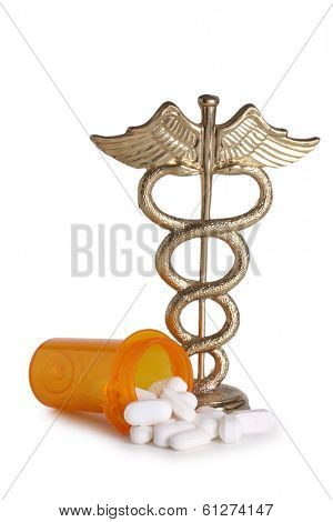 Pills and caduceus cutout on white background