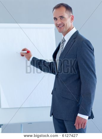Mature Businessman Writing In A Whiteboard