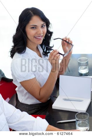 Smiling Businesswoman With Glasses In A Meeting